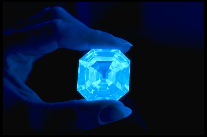 Photograph of the Portuguese diamond (G3898) fluorescing under ultraviolet light. Photo by Chip Clark